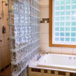 glass replacement panels in a bathroom remodel